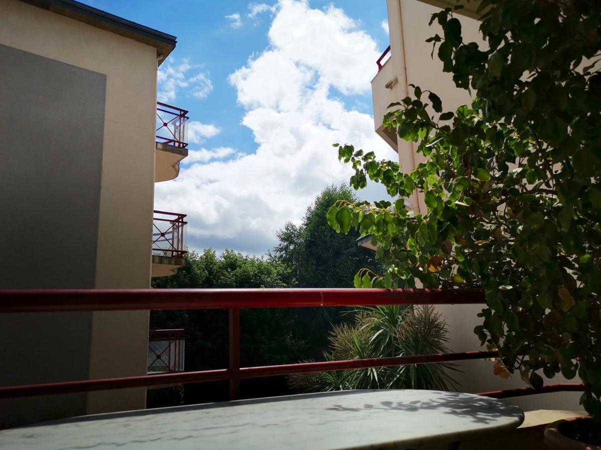 Centre-ville, appartement orienté plein sud, balcon et garag